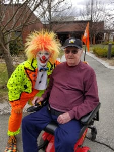 A clown poses for a photo with an MVH Bangor resident