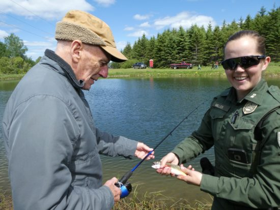 An MVH Caribou resident is assisted by a representative of Maine Inland Fisheries and Wildlife