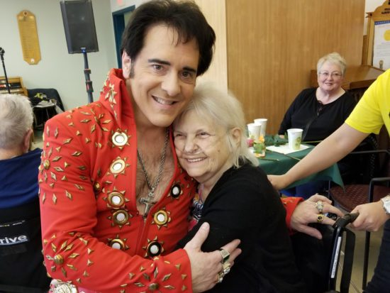An Elvis impersonator greets a Maine Veterans' Homes resident