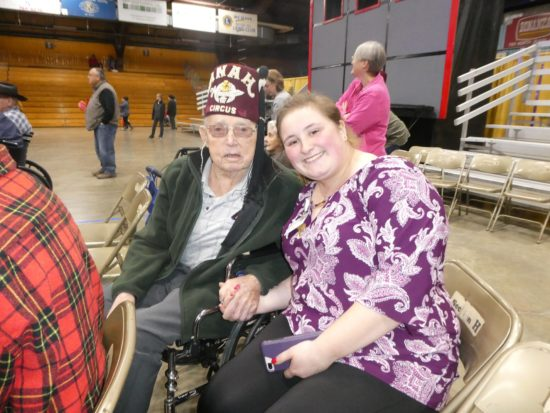 A Maine Veterans' Homes - Caribou resident and staff member enjoy the circus
