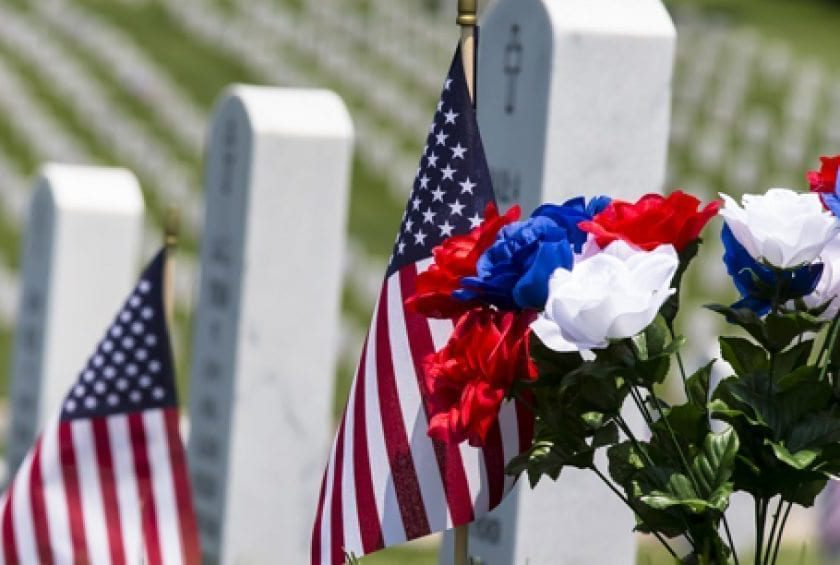 Veterans' cemetery with red, white and blue flowers