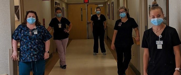 CNA students with instructor in hallway of MVH Augusta