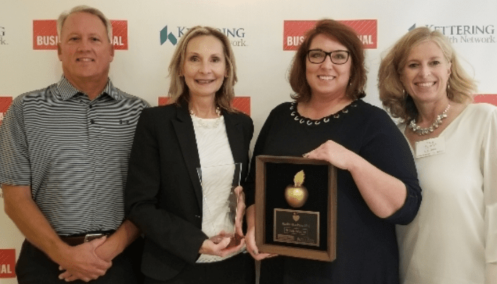 nk parts employees accepting healthiest employer award