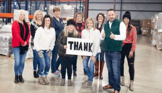 Versa Pak team members holding thank you sign while standing inside Celina, OH manufacturing plant