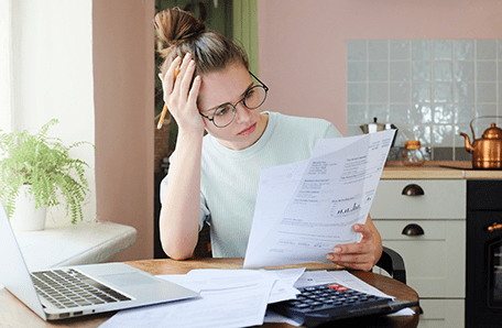College-aged woman looked at student loan paperwork