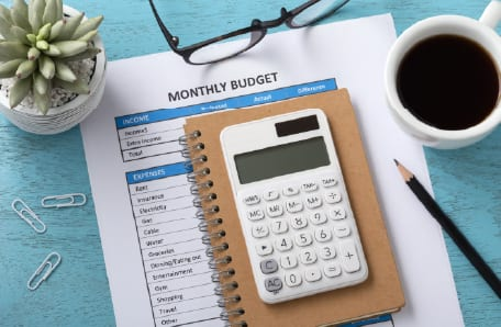 A group of budgeting tools on a desk.