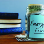 Glass jar with emergency fund money.