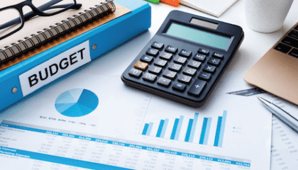 A person utilizing one of the seven tips for financial wellness, budgeting.