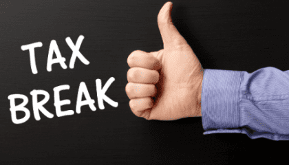 "Thumbs up with the words ""tax break"""