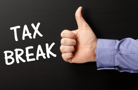 """Thumbs up with the words """"tax break"""""""