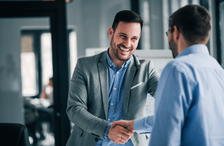 Young man shaking hands with a fellow business man