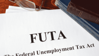 """Paper report with """"Federal Unemployment Tax Act"""" typed at the top"""