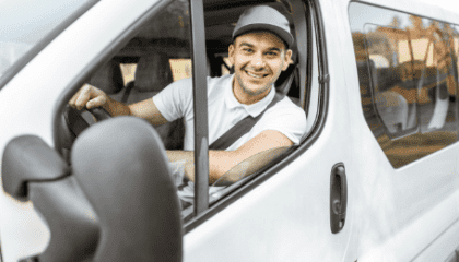 Business person driving a white van