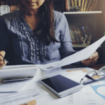 Woman at desk going over financial records