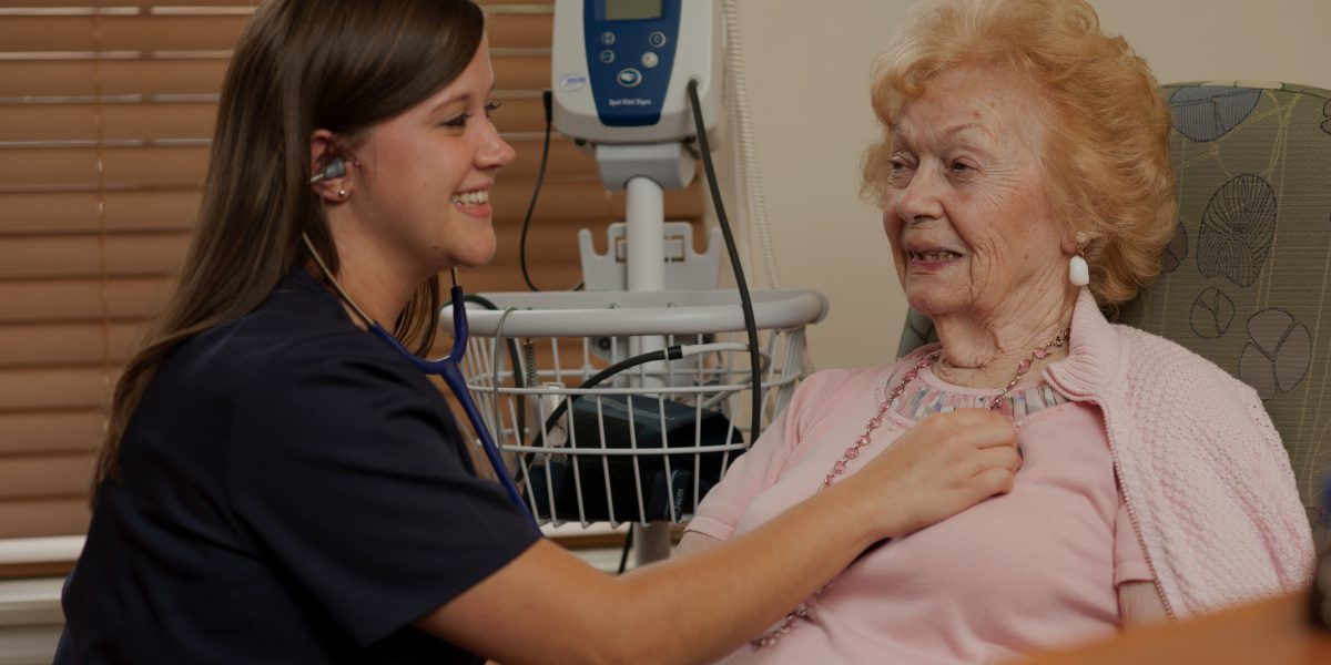 A nurse performs an evaluation of a resident in a rehab, nursing and assisted living community
