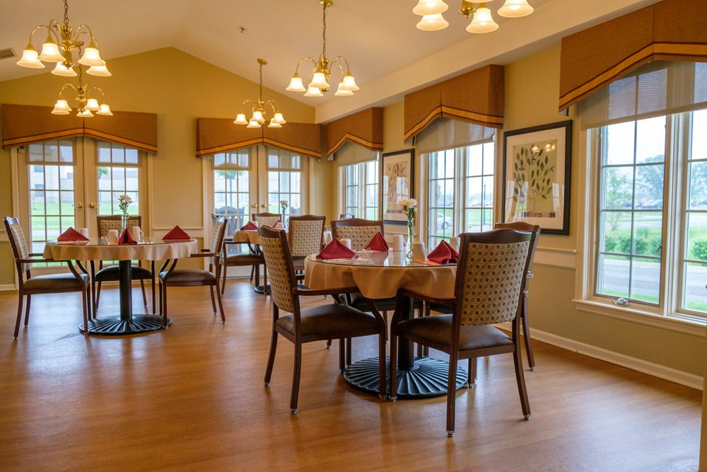 Dining room at Pickaway Manor with wide windows, tables and chairs