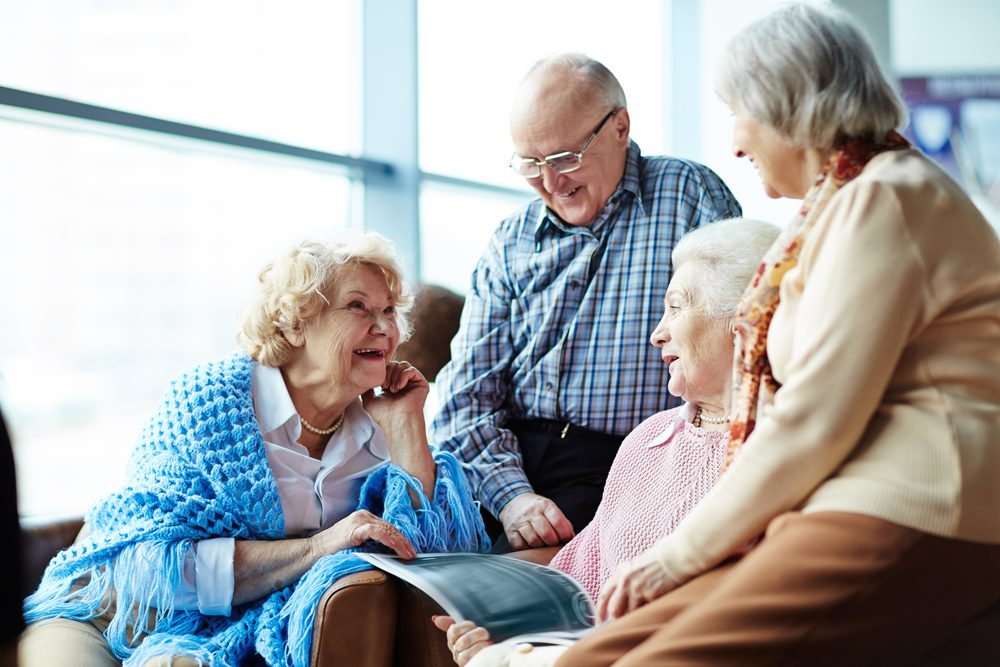 Senior friends discuss rehab, nursing and assisted living community options