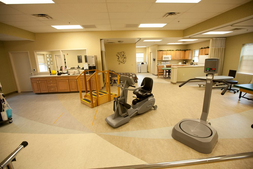 A modern and spacious therapy gym at a rehab and nursing center
