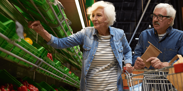 Senior woman post-hospital stay grocery shopping