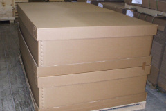 Large flat cardboard boxes with lids