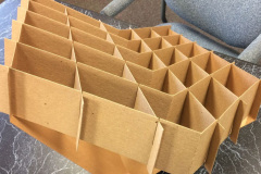 Cardboard inserts forming small squares