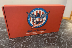 Red box with American seal and eagle design saying America Apparel