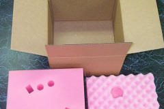 Cardboard box with two layers of protective pink foam