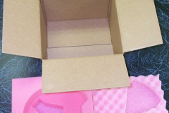 Cardboard box with protective pink foam inserts
