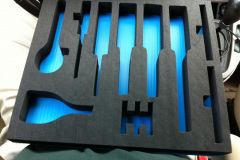 Custom foam insert with cutouts for parts