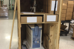 Custom vertical wood crate with medical equipment inside