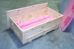 Large custom wooden crate with pink foam insert