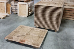 Custom pressed wooden pallet and stack of pallets