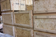 Custom wooden crates stacked in warehouse