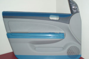 Car door with protective adhesive plastic