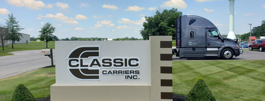 classic carriers sign and truck
