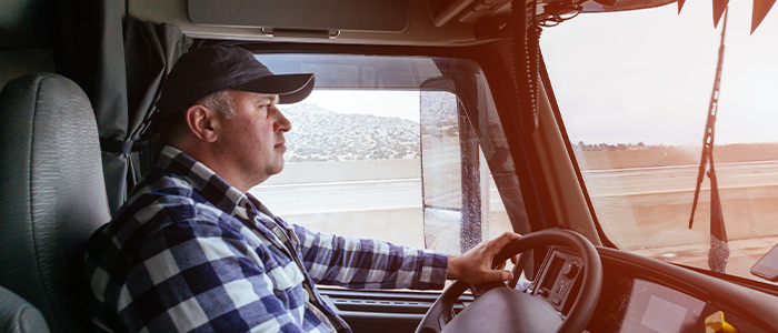 Focused truck driver driving safely