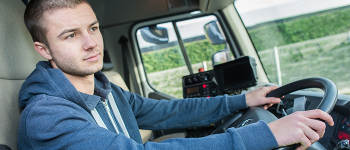 Young man driving a semi truck